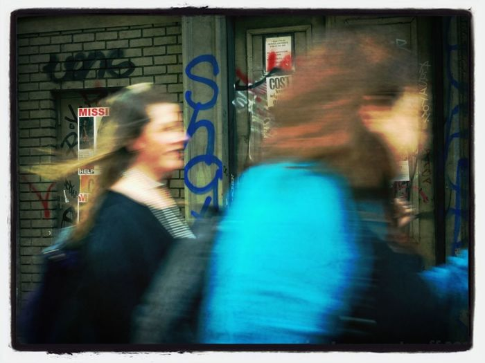 Blurred motion of woman in city