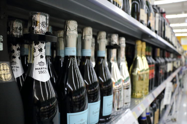Wine Not Bottle In A Row Shelf Drink Choice Indoors  Alcohol Wine Bottle Food And Drink Business Finance And Industry Store Variation Large Group Of Objects Retail  No People Industry Day Food Close-up