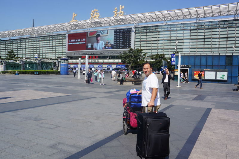 Man With Luggage At Shanghai Railway Station