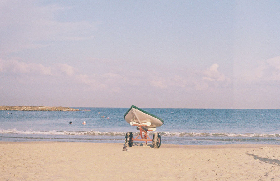 a day at the beach shot on film Film Photography Filmisnotdead Sky Sea Water Beach Land Horizon Over Water Horizon Scenics - Nature Nature Cloud - Sky Sand Day Beauty In Nature Transportation Men Real People Motion Tranquil Scene Tranquility Outdoors