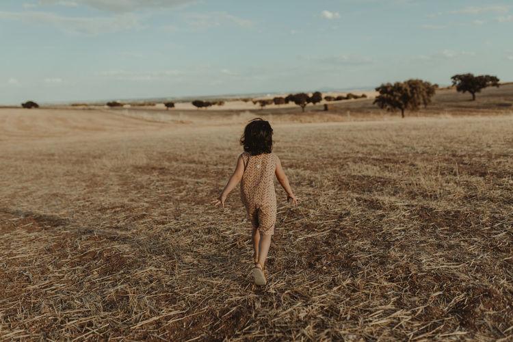 Child running through the fields
