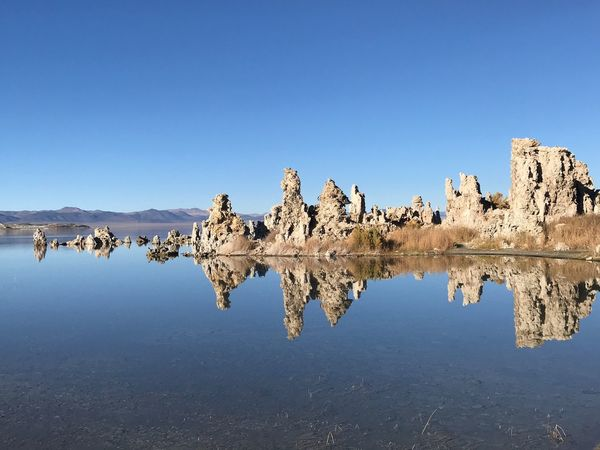 Next stop on our road trip - Mono Lake CA. A stunning crater lake with tuff formations Reflection Nature Blue Copy Space Beauty In Nature Clear Sky No People Tranquil Scene Tranquility Water Outdoors Day Lake Scenics Cold Temperature Winter Mountain Sky Mono Lake California Tuff Crater Lake