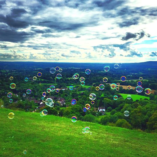 Cloud - Sky Sky No People Nature Outdoors Beauty In Nature Grass Scenics Day Landscape Bubbles Grassland Multicolour Multi Colored Hill Childhood Bubble Bubbles In The Sky Bubbles... Bubbles...Bubbles.... Blowing Bubbles EyeEm Diversity Art Is Everywhere The Great Outdoors - 2017 EyeEm Awards Sommergefühle Rethink Things
