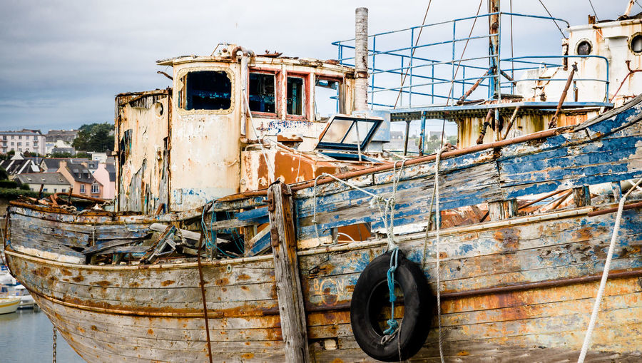 Abandoned boat moored at river