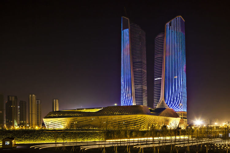 Scenic view of illuminated building at night
