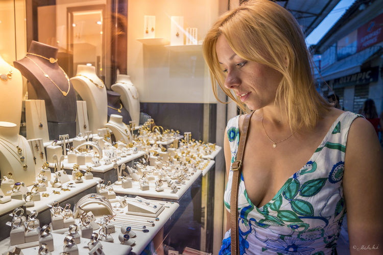 Beautiful woman standing at jewelry store