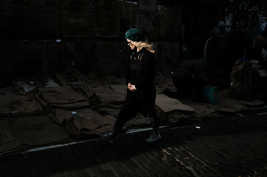 A young lady catches specular light walking through Brick Lane Market, East London, UK Blonde Brick Lane FUJIFILM X-T2 London London Market Market Woman Day Daylight East London Full Length One Person Outdoors Photography People Real People Street Streetphotography Walking