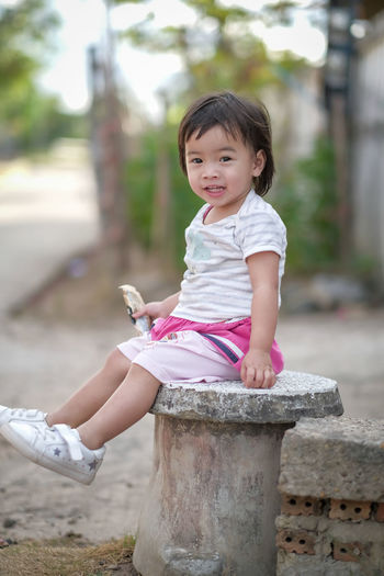 Cute girl sitting outdoors