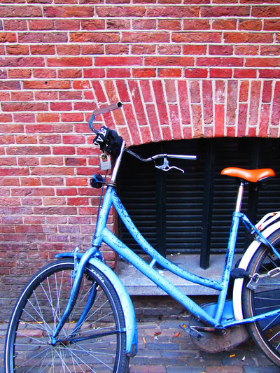 Bicycle Series Brick Wall Colors Cycling Day Mode Of Transport No People Outdoors Pedal Transportation Architecture Motion Wall - Building Feature Street Life Cycling Photography Architecture_collection Street Photography City Wall - Building Feature Street Photography EyeEmBestShots Built Structure Red