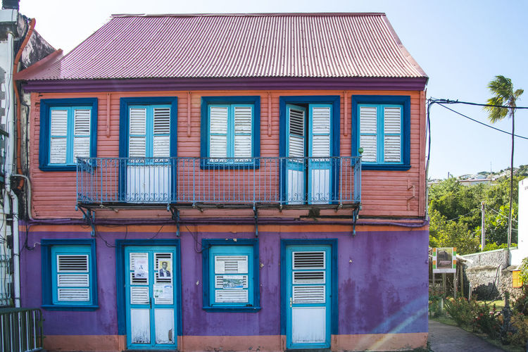 Martinique, Case Pilote Martinique Tradition Architecture Blue Building Building Exterior Built Structure Caribbean City Day Façade Glass - Material House Island Nature No People Old Outdoors Plant Reflection Residential District Row House Sky Traditional Tree Tropical Tropical Climate Window