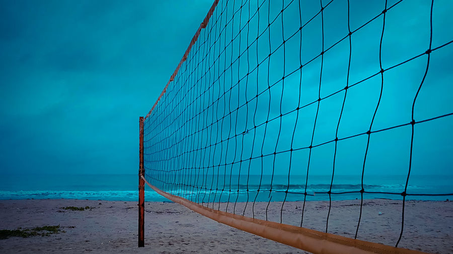 Beach Volleyball Court on a Rainy Day Sea Water Beach Blue Sky Land Nature Day Net - Sports Equipment Horizon Over Water Sand Horizon Outdoors Beauty In Nature Scenics - Nature No People Pattern Cloud - Sky Volleyball - Sport Turquoise Colored
