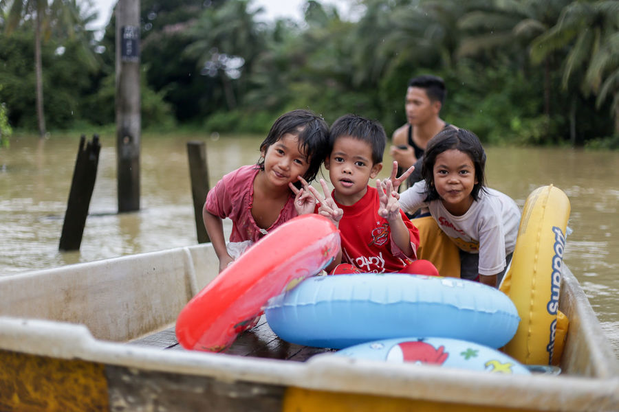 flood victims at kelantan Flood Victim Boys Childhood Day Elementary Age Enjoyment Family Father Front View Fun Girls Happiness Leisure Activity Lifestyles Looking At Camera Mature Adult Mature Women Outdoors Portrait Real People Sitting Smiling Son Togetherness Young Women