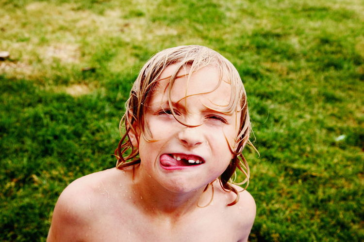 Boy Childhood Children Cute Day Enjoying Life Family Fun Grass Headshot Human Face Kids Kids Being Kids Moments Outdoors Outside Person Playing Portrait Summer Tooth Toothy Smile Water