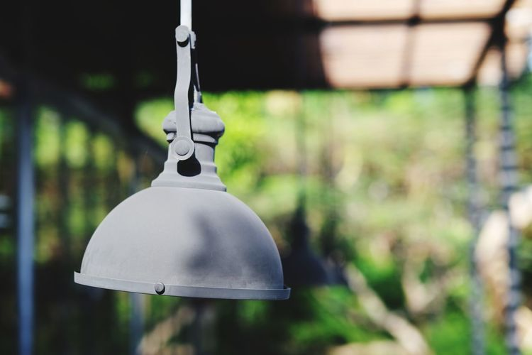 Close-up of electric lamp hanging in yard