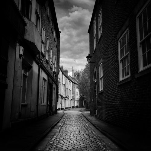 The cobbled streets of Hull Architecture Building Exterior Built Structure Direction The Way Forward Building City Street No People Outdoors Alley vanishing point Cloud - Sky Residential District Empty Narrow Sky Day