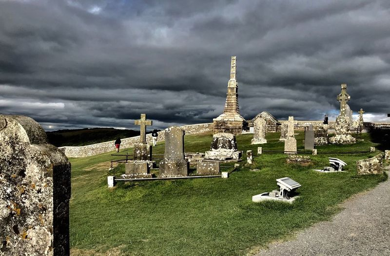 Dark Skies About To Storm Gaelic Storm Rest In Peace Grey Sky And Peaceful Resting Place Cloud - Sky Sky Architecture Built Structure Grave Building Exterior Cemetery