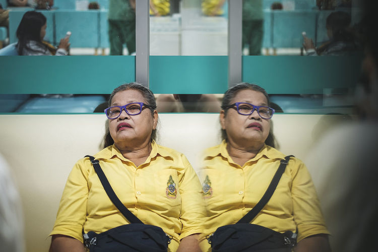 Multiple image of senior woman in waiting room