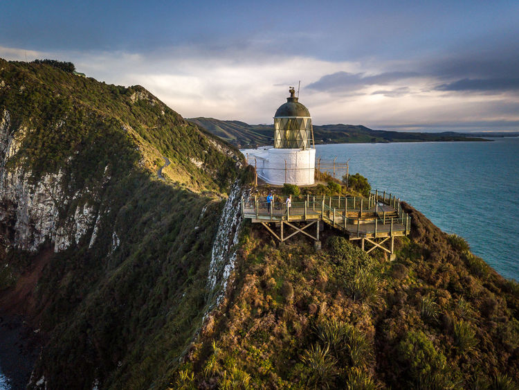 Nugget Point Lighthouse, Dunedin, Otago, New Zealand Dunedin New Zealand Nugget Point Lighthouse Otago Peninsula Architecture Beauty In Nature Building Building Exterior Built Structure Cloud - Sky Day Direction Guidance Lighthouse Ligthouse Mountain Nature New Zealand No People Outdoors Plant Scenics - Nature Sea Sky Tower Water