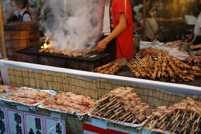 Skewers on barbecue grill at food stall