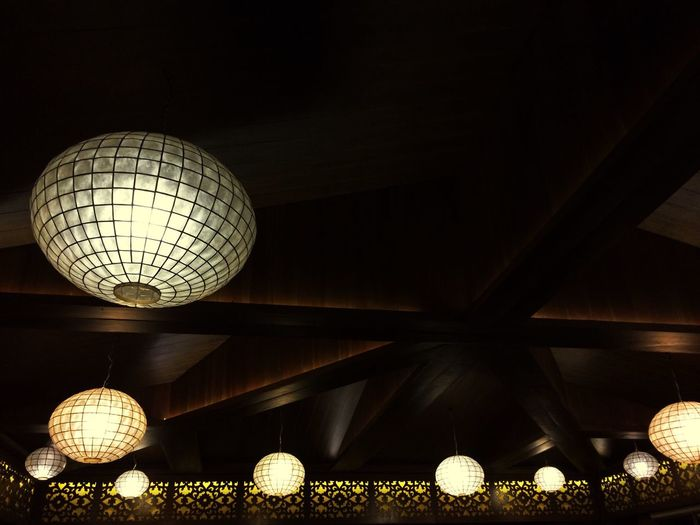 Illuminated lights hanging from ceiling
