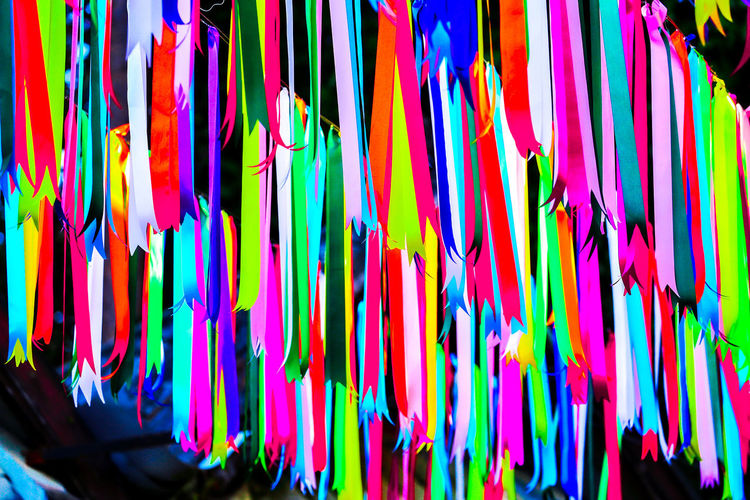 Multi colored flags hanging for sale in market