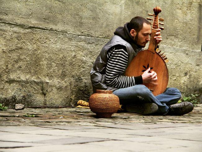 Streetphotography Streetmusician Ukraine Ukrainian  Outdoors Sitting Poor  Lviv Man Music Musician Eyem Vision Up Close Street Photography