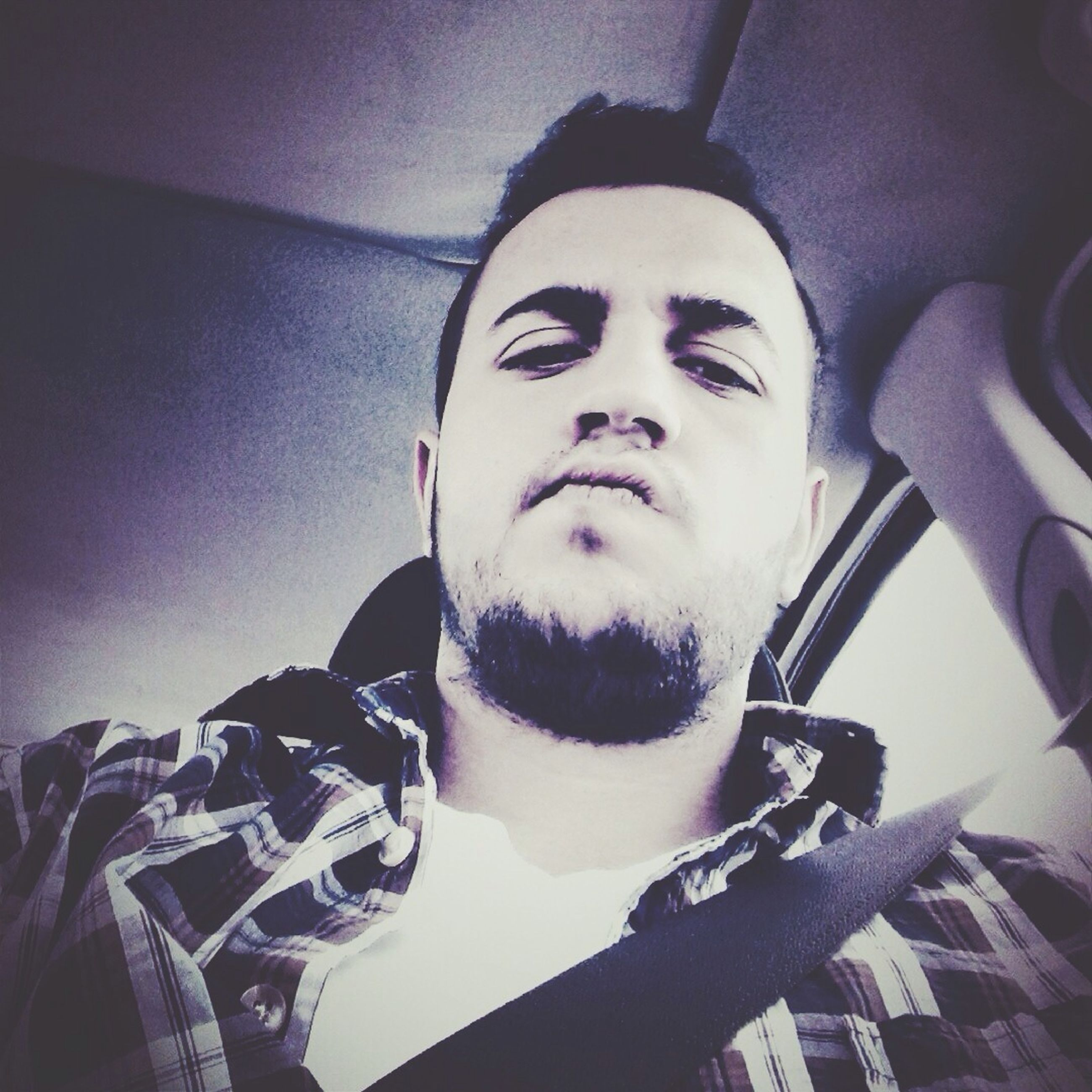 indoors, lifestyles, young adult, headshot, looking at camera, leisure activity, portrait, transportation, person, mode of transport, young men, car, beard, front view, close-up, land vehicle, head and shoulders, vehicle interior