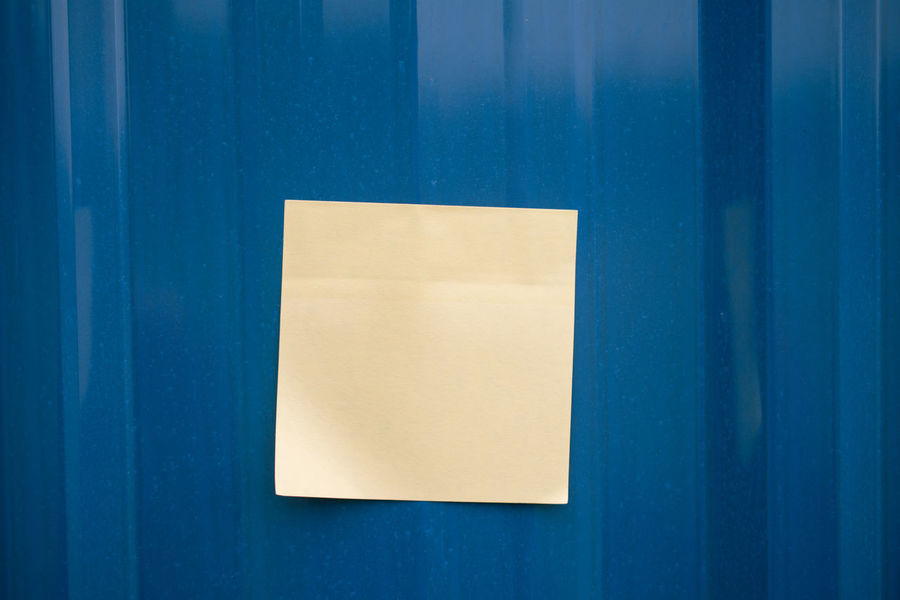 Sticky note on the blue wall Sticky Notes URGENT Blank Blue Business Finance And Industry Close-up Conceptual Day Important Indoors  Memo No People Note Reminder