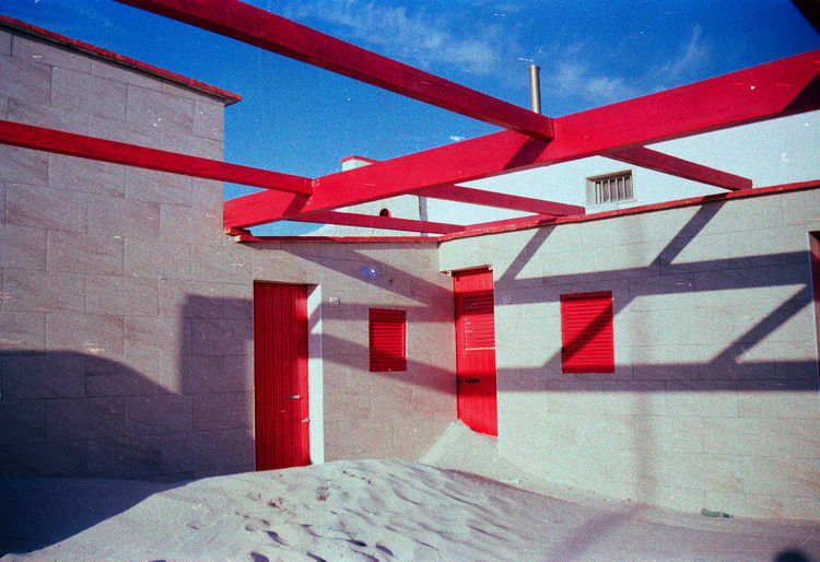 Close-up of red built structure against the sky