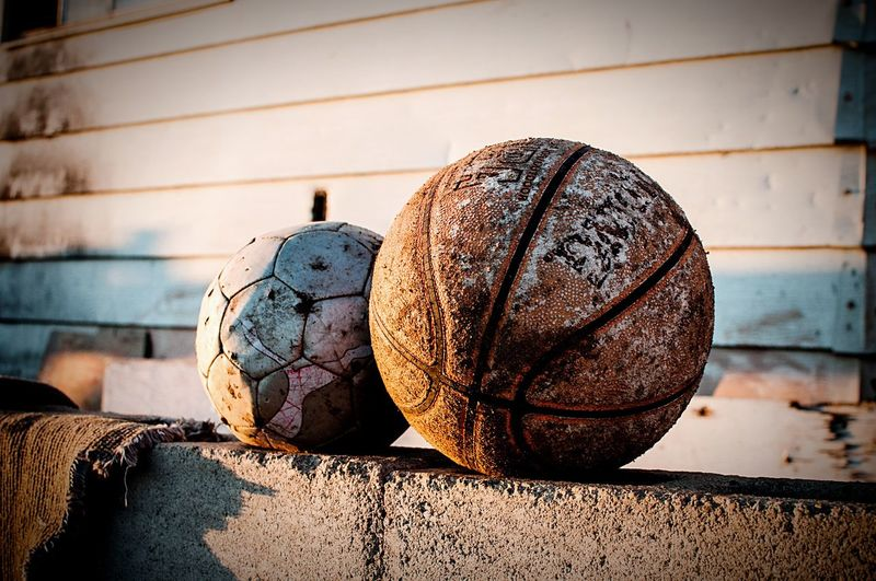Well Loved // Carefully placed on the wall in front of a simple home, the fact that these worn balls were still inflated was miraculous. The boys who live here and the neighborhood children play games of pick up soccer on the dirt roads over looking the ocean. If hit too hard a ball could head over a cliff and be gone forever, but because they have so few things and the balls are so valued by the boys who own them, they have survived. If only children who lived in the developed consumer crazy world a short distance away could value their things this way. How to contribute more to the world and consume less are qualities I would like my own kids to posses. These balls are a symbol of that for me. Child Poverty Children Happiness Beautiful Poverty Photojournalism Project Esperanza Mexico Beyond The Border Border Stories Nikon Beauty Redefined Soccer Futbol Basketball Sport Ball Gratitude Documentary Documentary Photography The Photojournalist - 2016 EyeEm Awards The Photojournalist – 2016 EyeEm Awards The Street Photographer - 2016 EyeEm Awards Feel The Journey Fine Art Photography