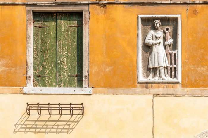 Wall details in Venice, Italy Façade Italy 🇮🇹 Wall Architecture Bas Relief Building Exterior Built Structure Day Facade Detail Flower Pots Holder No People Old Window Blind Old Windows Outdoors Stone Carving Venice Window Wooden Blinds