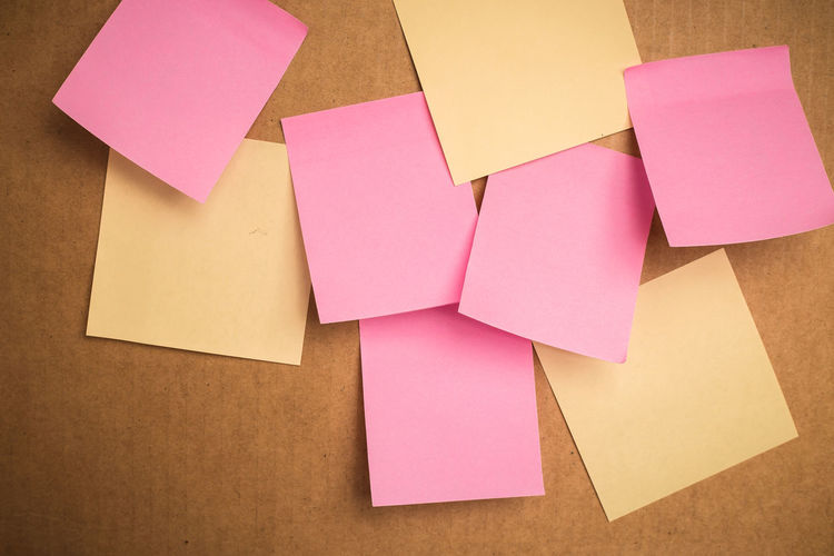 Close-up of blank sticky notes on cardboard box