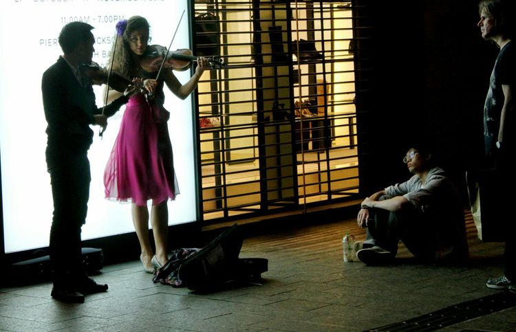Untold Stories Collected Community Creative Light And Shadow Street Entertainment Playing The Violin. Street Photography Street Artist Popular Photos EyeEm Gallery Capturing Freedom Women Who Inspire You Up Close Street Photography Fine Art Photography People Together Magic Moments People And Places
