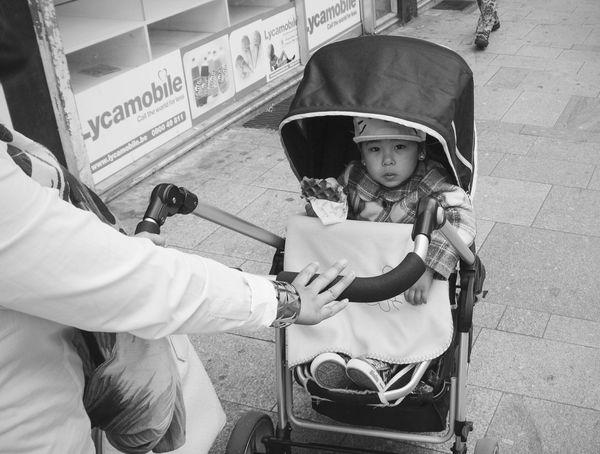 Streetphotography Streetphotography_bw Kid eating a Waffle The Street Photographer - 2015 EyeEm Awards B&w Street Photography Up Close Street Photography
