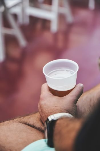 Midsection of man holding drink