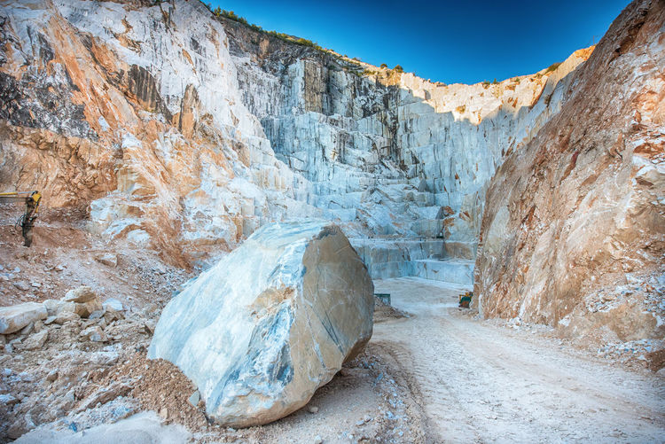 Open cast mining pit for italian carrara marble showing the rock face