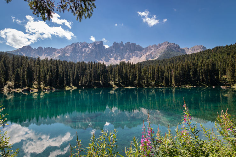 Panoramic view of carezza lake and mountains against sky