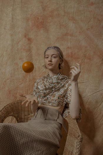 2019's freshest ! 'Citrus Garden' Citrus Fruit TheWeekOnEyeEM Leisure Activity Holding Hairstyle Fashion Relaxation Lifestyles Clothing Sitting Beautiful Woman Young Adult Beauty Vitamin C