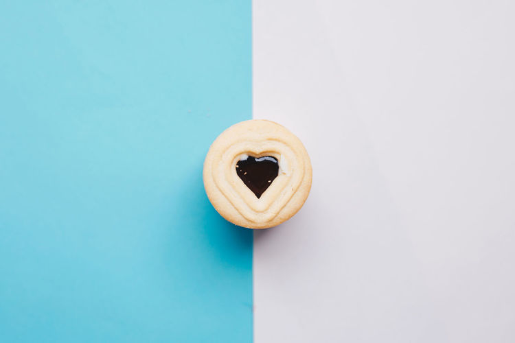 Heart shape cookie over colored background