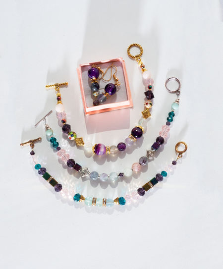 High angle view of multi colored bead on white background