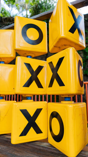 XOXO Yellow No People Communication Day Construction Industry Large Group Of Objects Stack Close-up Focus On Foreground Outdoors Sign Construction Site Still Life Retail  Letter Transportation Arrangement Low Angle View For Sale Capital Letter Noughts And Crosses