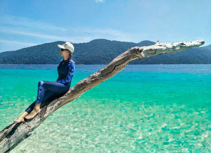 On the Sea Adult Beauty In Nature Blue Clothing Day Full Length Hat Holiday Leisure Activity Nature Nautical Vessel One Person Outdoors Sea Sky Transportation Trip Turquoise Colored Vacations Water Young Adult