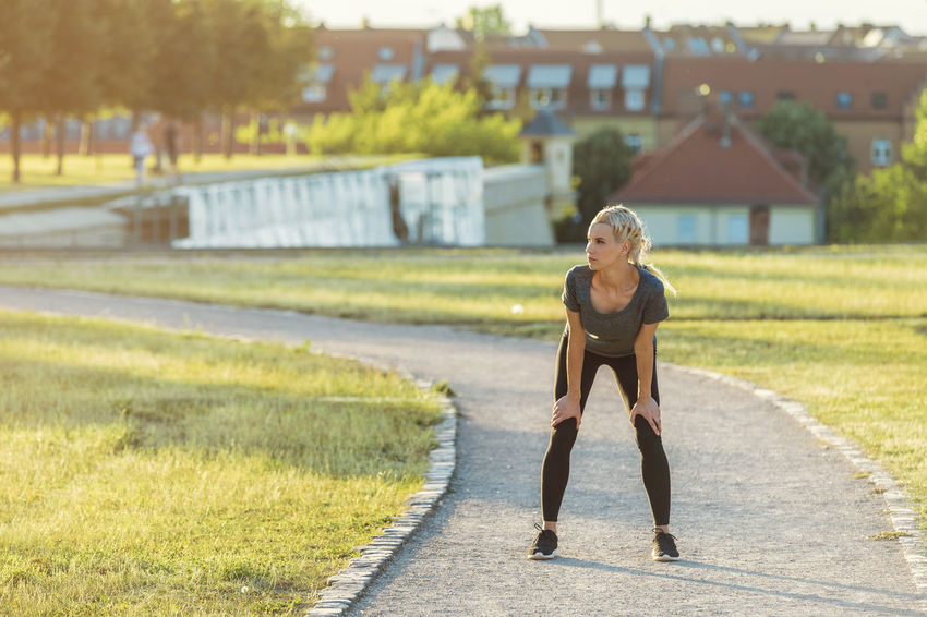 Blond Woman Running In The Park Beautiful Running Walking Around Woman Blond Braided Cardio Day Fit Focus Focus On Foreground French Braid Gravel Path Healthy Jogging Lawn Leggings Lifestyles One Person Outdoors Park Pretty Real People Sunset Young Adult