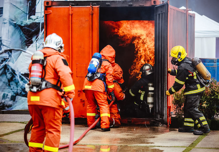 Figters against fire in container