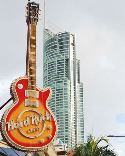Hard Rock Cafe Guitar Highrise Background Orange Color Musical Instruments Iconic Gold Coast Australia Gold Coast Surfers Paradise Surfersparadise Queensland Australia City Showcase: February Blue Wave The Architect - 2016 EyeEm Awards Colour Of Life Music Brings Us Together