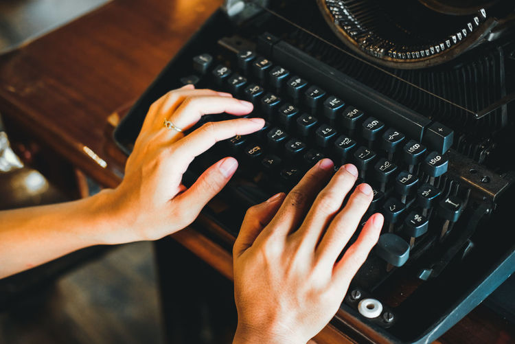 High angle view of person using vintage keyboard