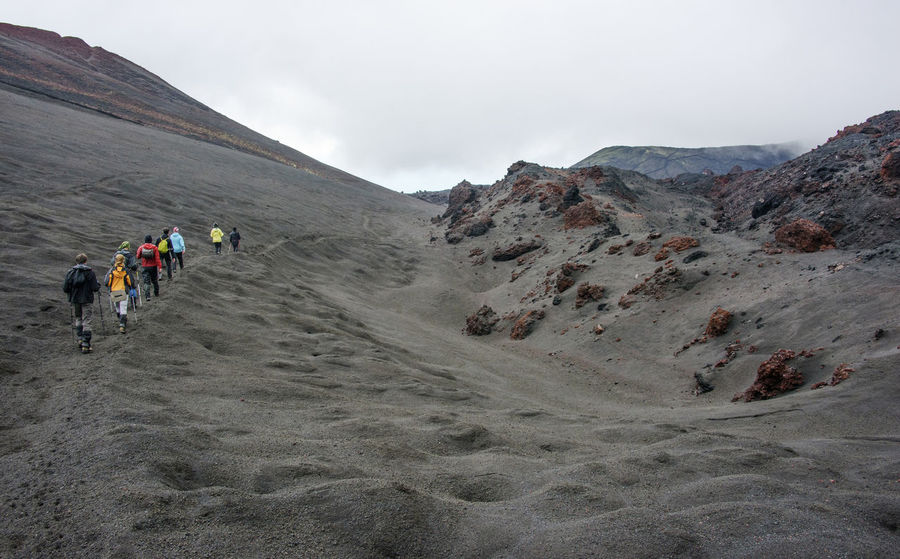 Hikers go through volcanic desert at Kamchatka Cloud - Sky Day Far East Hiking Kamchatka Large Group Of People Men Mountain Nature Outdoors People Rear View Russia Sky Togetherness Vacations Young Adult