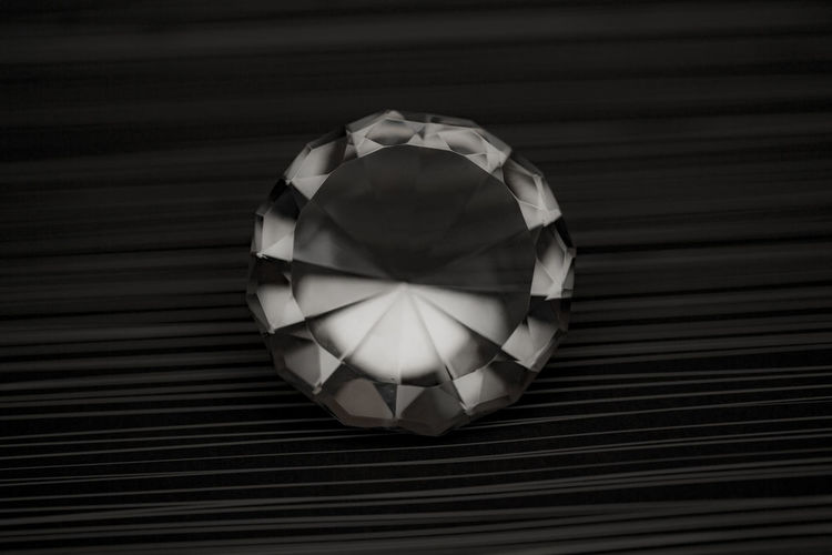 Close-up of diamond on striped table