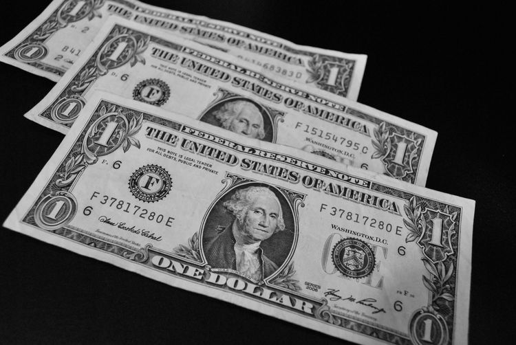 Currency Paper Currency Finance Human Representation Black Background Indoors  Representation Studio Shot Male Likeness Business Wealth Number Close-up Text Still Life Communication No People Western Script Economy
