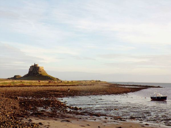 EyeEm Selects Sea Sunset Outdoors Travel Destinations No People Landscape Beach Tourism Whatisee Breathing Space Castle Castle Tower Travel Honeyisland Scenics Water Nature Sand Day Cloud - Sky Horizon Over Water Lindisfarne Castle Lindisfarne Uk